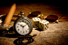 Antique Pocket Watch and Old Gambler Craps Dice royalty free stock photos