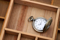 Antique pocket watch with chain. Antique pocket watch in old wooden container Royalty Free Stock Photo