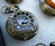 antique-pocket-watch-with-ornamented-bronze-casing Royalty Free Stock Images