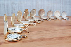 Antique pocket watch in a row with the lid open. Stock Photo