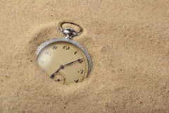 Antique pocket watch in sand Stock Image