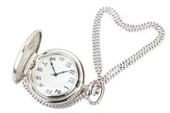 Antique pocket watch and silver chain. Antique pocket watch and silver chain in the shape of heart Stock Image