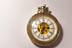 Antique pocket watch with visible mechanism.  Stock Photos