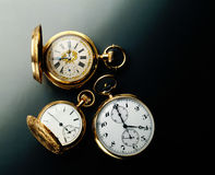Antique Pocket watches. Elegant antique pocket watches on a black background Royalty Free Stock Image