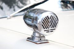 Antique police Siren. On an old highway patrol car Royalty Free Stock Images