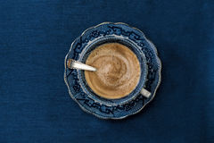 Antique porcelain blue and white coffee cup royalty free stock photos