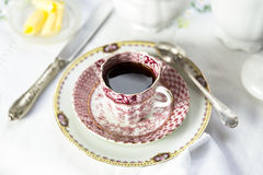 Antique porcelain breakfast setting with black cof Royalty Free Stock Images