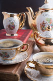 Antique porcelain coffee cups with coffee and crockery Stock Photos