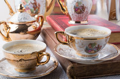Antique porcelain coffee cups with hot coffee Stock Images