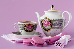 Antique porcelain coffee cups with hot espresso and tableware Stock Photo