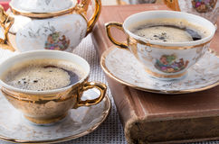 Antique porcelain coffee cups with hot espresso Stock Image