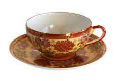 Antique porcelain cup and saucer Royalty Free Stock Images