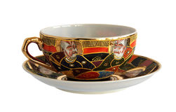Antique porcelain cup and saucer. An antique porcelain cup and saucer isolated on white background Royalty Free Stock Photos