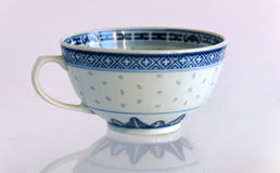 Antique porcelain cup and saucer Rice grain Stock Image