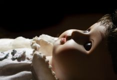 Antique porcelain doll. A closeup of the face of a porcelain doll Royalty Free Stock Images
