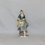 Antique porcelain figurine Royalty Free Stock Photo