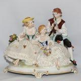 Antique porcelain figurine Stock Images