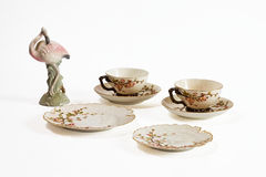 Antique porcelain and flamingo statue Royalty Free Stock Photography
