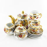 Antique porcelain tea and coffe set with flower motif Stock Images