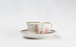 Antique porcelain tea cup with floral painting Stock Photo
