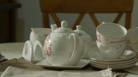 Antique porcelain tea set. Old antique porcelain white tea set on the table stock video