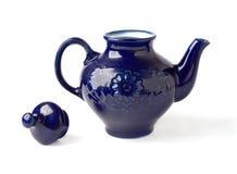 Antique porcelain teapot blue on white background. Antique porcelain teapot blue on a white background Stock Photo