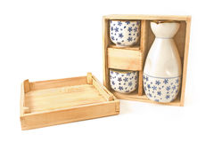 Antique porcelain vase and cups in wooden box Stock Photo