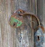 Antique portable metal padlock on wooden door. Antique portable padlock made from metal on wooden door royalty free stock photos