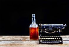 Antique Typerwriter and Whisky Bottle. Stock Images