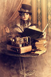 Antique. Portrait of a beautiful steampunk woman over vintage background Stock Photos