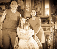 Antique portrait of happy family. With Christmas tree at home Royalty Free Stock Image
