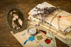 Antique portrait and old letters. Antique portrait of a woman and a bundle of old letters on a wooden table Royalty Free Stock Photo