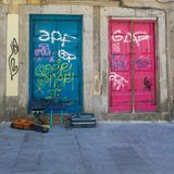 Antique Portuguese Architecture: Old Colorful Doors, Writings and Guitar in the Street - Portugal.  Stock Photography