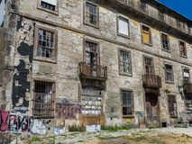 Antique Portuguese Architecture: Wrecked Building Facade. In Porto Royalty Free Stock Image