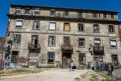 Antique Portuguese Architecture: Wrecked Building Facade in Oporto.  Royalty Free Stock Photo