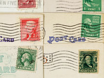 Antique postcards and cancelled stamps Stock Photography