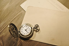 Antique postcards with vintage pocket watch Royalty Free Stock Photo