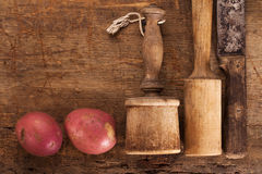 Antique potato mashers and knife Royalty Free Stock Photo