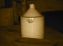 Antique Pottery Gallon Jug In Sepia Tone Royalty Free Stock Photos
