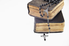 Antique prayer-books and a black rosary on it Stock Photo