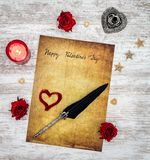 Vintage Valentine`s Day card with red candle and roses, painted hart, ink and quill - top view stock photos
