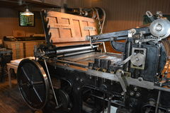 Antique Printing Press. In printing room of historic village Stock Photo