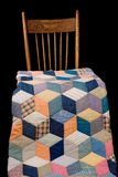 Antique Quilt And Kitchen Chair. Late nineteenth century quilt and chair, black iso Stock Images