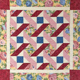 Antique quilt. Pattern of a colorful antique quilt with floral borders stock images