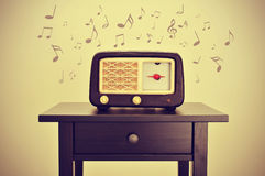 Antique radio and musical notes Stock Images