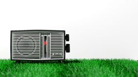 Antique radio transistor on grass Stock Images