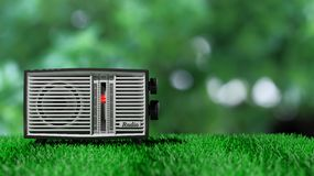 Antique radio transistor on green grass Royalty Free Stock Photo