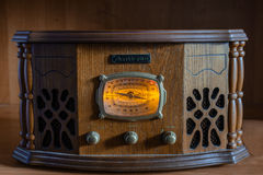Antique radio on vintage background. Antique radio on wooden vintage background Stock Image