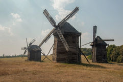 Antique ramshackle wooden windmill, Pirogovo Royalty Free Stock Photo