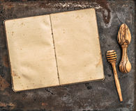 Antique recipe book and wooden kitchen utensils Stock Photography